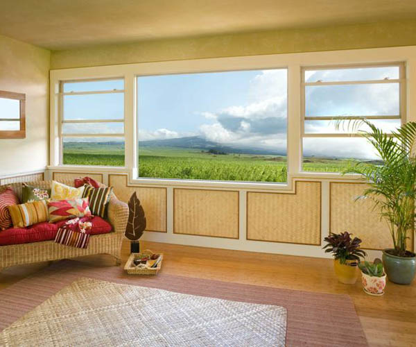 Jeld Wen: White Vinyl Double-Hung Windows flank a Picture Window